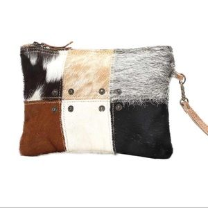 Button hair on Wristlet clutch